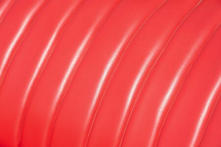 luxurious red leather vintage car seat upholstery in sunlight