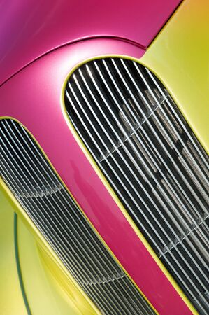 magenta and lime vehicle panels and engine grille closeup Standard-Bild
