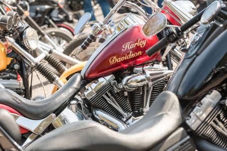 Closeup of a Harley Davidson motorcycle fuel tank and other bikes in Rushmoor, UK - April 19, 2019