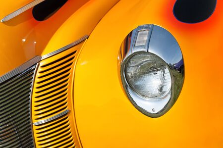 retro vehicle grill abstract in sunset shades of yellow and orange Standard-Bild