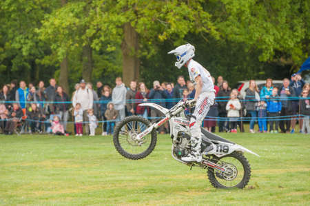 Ash Rilings landing a motorcycle jump while performing in the Stunt Mania extreme sports show in Yateley, UK on May 6, 2019 Editorial