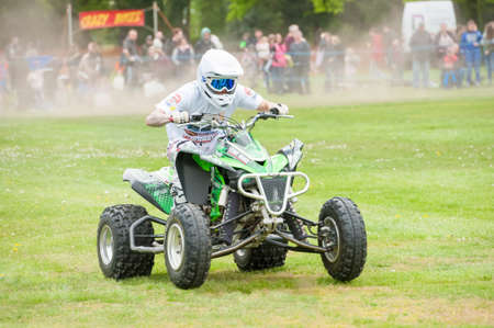 Ash Rilings riding a speeding quadbike while performing in the Stunt Mania extreme sports show in Yateley, UK on May 6, 2019