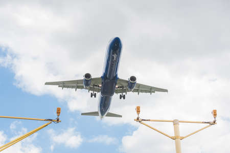 passenger jet on landing approach to an airport with its undercarriage down Editorial