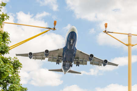 large passenger jet on landing approach to an airport with its undercarriage down Standard-Bild