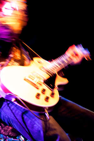 motion blur abstract of a rock guitarist with a golden guitar