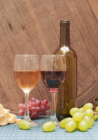 Glasses of wine on a wine barrel Stock Photo - 10923803