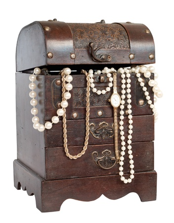 old chest with pearl necklace , isolated on white photo