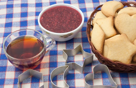 cookies with cutters , tea , and raspberry jam Stock Photo - 11011308