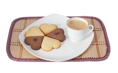 tasty cookies at plate closeup with coffee cup  photo