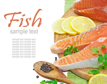Fresh salmon steak filet, ginger, lemon. Over white with sample text  photo