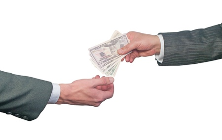 Hand handing over money to another hand isolated on white background photo