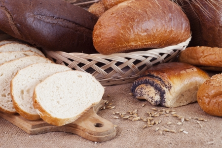 composition of bread and wheat spikelets photo
