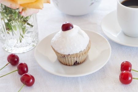 Breakfast  cherry muffins with coffee photo