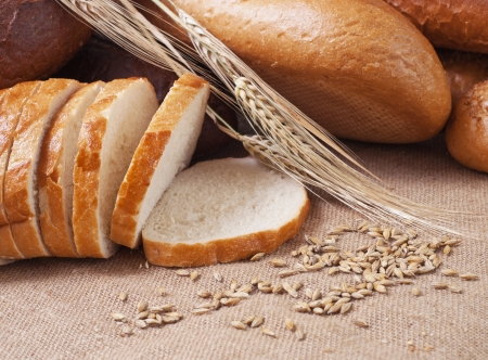 composition of bread and wheat spikelets Banco de Imagens