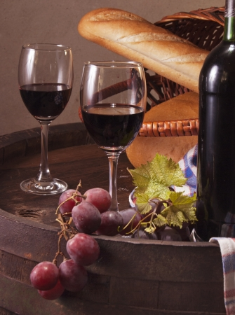 Still life with wine barrel, bread and cheese photo