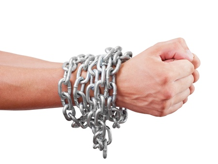 tortured: Mens hands inhibitions chain. Isolated on white background