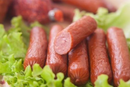 Macro shot of sausages and salad photo