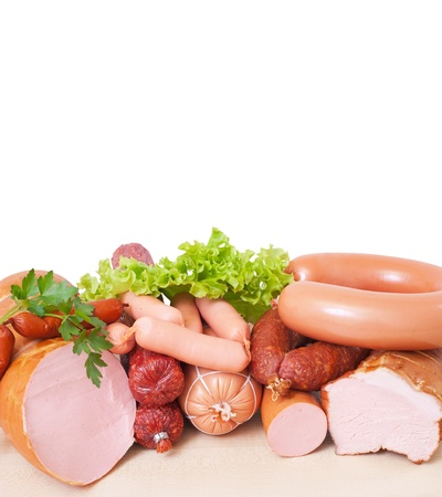 Meat and sausage   Isolated on a white background , with clipping path included photo