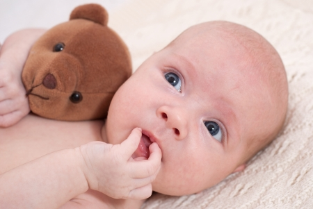 Newborn baby with toy Stock Photo - 17099100