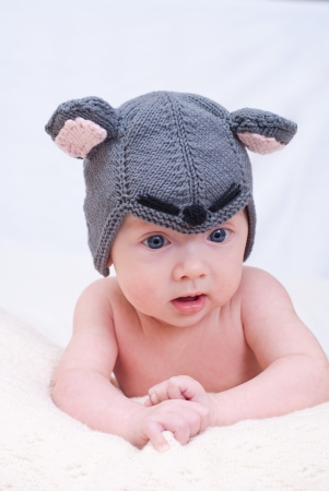 purpule: Newborn baby girl in a mouse cap