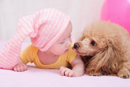 Newborn baby whith dog photo