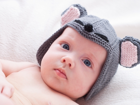 Newborn baby girl in a mouse cap photo