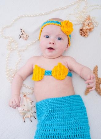 seamaid: Baby girl dressed as a mermaid