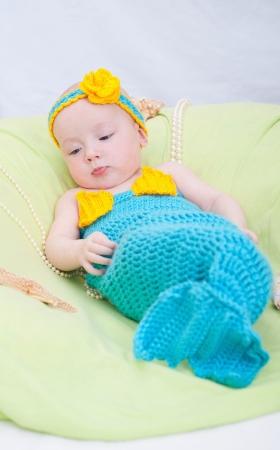 undine: Baby girl dressed as a mermaid