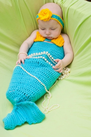 purpule: Baby girl dressed as a mermaid