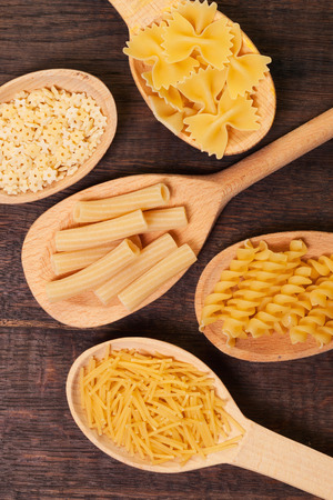 Pasta on wooden background photo