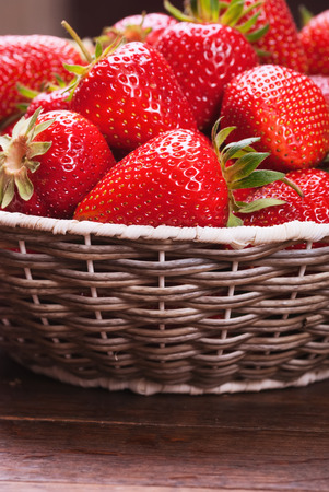 many red ripe strawberries  food background photo