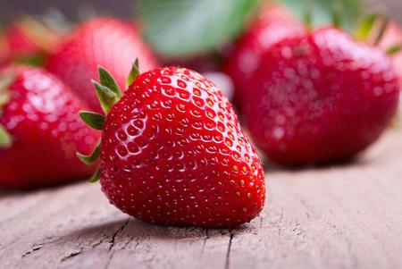 many red ripe strawberries. photo