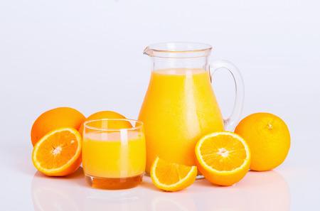 Freshly orange juice on white background   photo
