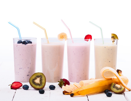 Fruit smoothies with blueberries , strawberry, kiwi and banana isolated on white background