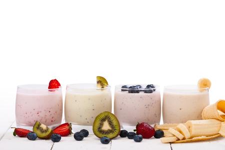 Fruit smoothies with blueberries , strawberry, kiwi and banana isolated on white background photo