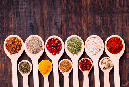 indian ocean: collection of various spices in wooden spoons