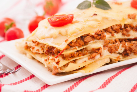 Close-up of a traditional lasagna made with minced beef bolognese  photo