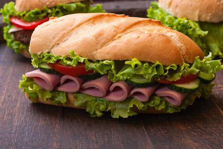 Sandwiches - turkey breast, ham & swiss and salami photo