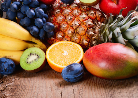 Many fresh colorful fruits on wooden  photo
