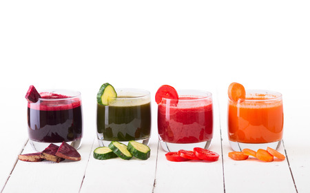 Vegetable juice (carrot, beet, cucumber, tomato). Isolated on white background with clipping path included Banco de Imagens