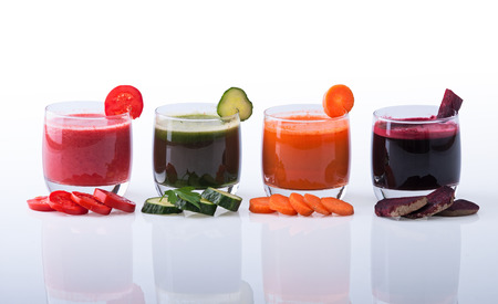 Vegetable juice (carrot, beet, cucumber, tomato). Isolated on white background with clipping path included photo