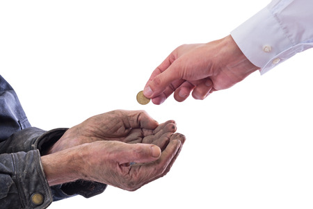 A beggar receiving money from a kind manÑŽ Isolated on white background with clipping path included .