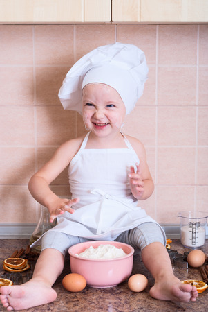 little girl in the cook costume photo