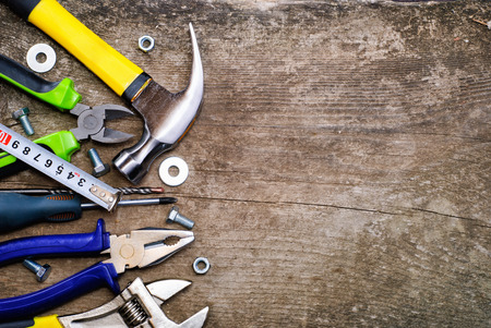 carpentry tools: Set of tools over a wood background