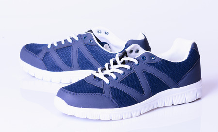 blue shoes: Running blue shoes. Bright Sport sneakers symbol.