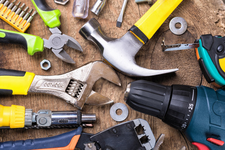 building tool: Set of tools over a wood background