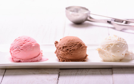 ice cream scoop: three scoops of ice cream ( chocolate , vanilla , strawberry ) Stock Photo
