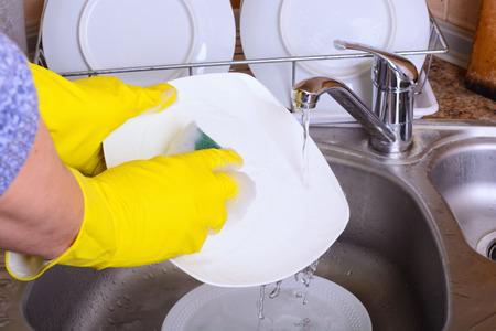 Cleaning dishware kitchen sink sponge washing dish photo