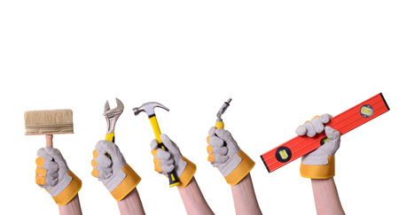 Tools in hand . Isolated on white background . photo