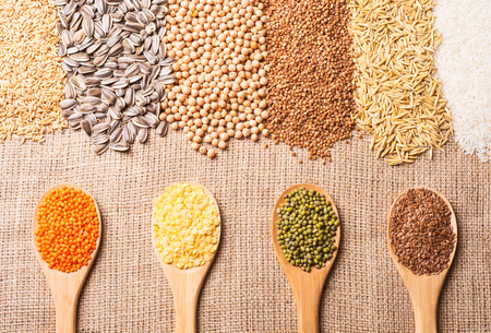 wild oats: Cereal grains , seeds, lentil, beans on wooden background.